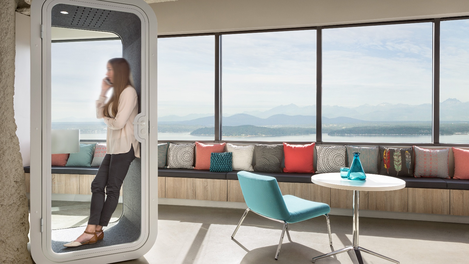 A compact phone booth in an activity-based office provides a private space for making important phone and video calls.