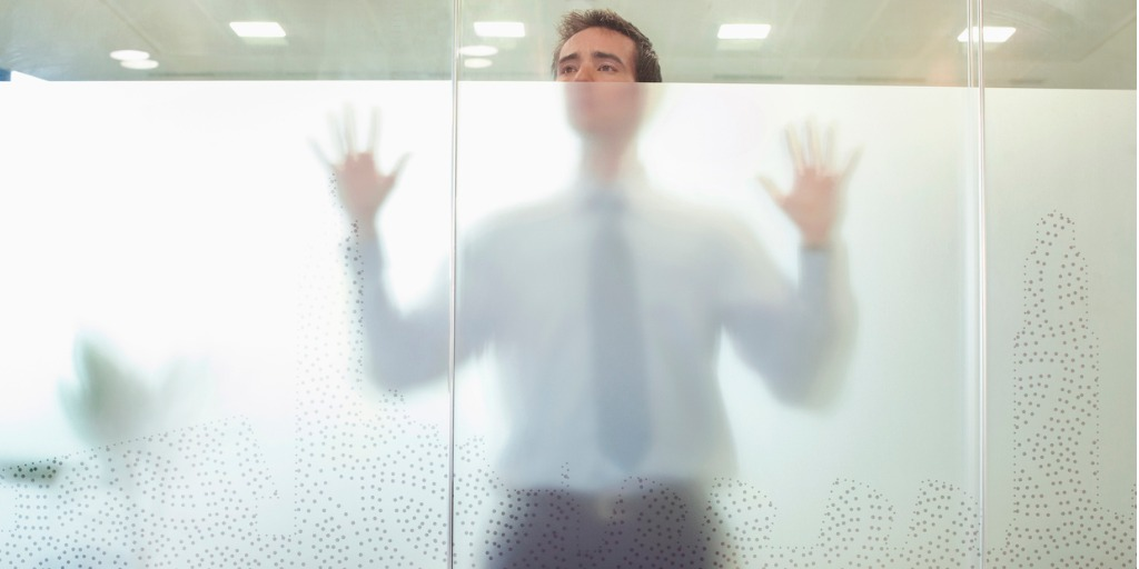 business-executive-standing-behind-glass-door-picture-id106061859